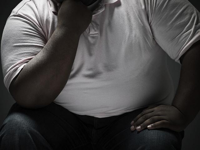 black man tummy, yes GUT