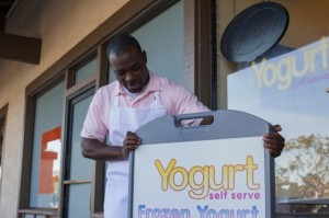 Man opening frozen yogurt store