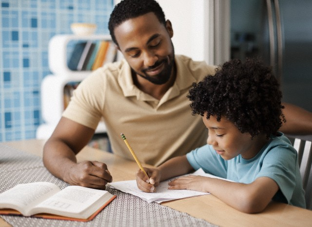 Father helping not her daughter in schoolwork by troc 6