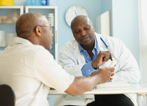 Patient discussing prescription medication with doctor