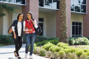 Female African American college student and mother walking on campus