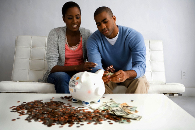 Young African American couple discusses finances