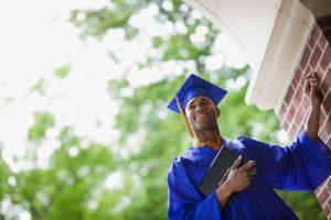 Young Man Holding Diploma