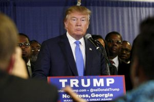 U.S. Republican presidential candidate Donald Trump surrounded by members of Atlanta's black clergy speaks at a news conference prior to a rally in Norcross, Georgia