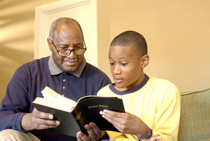 black man reading bible